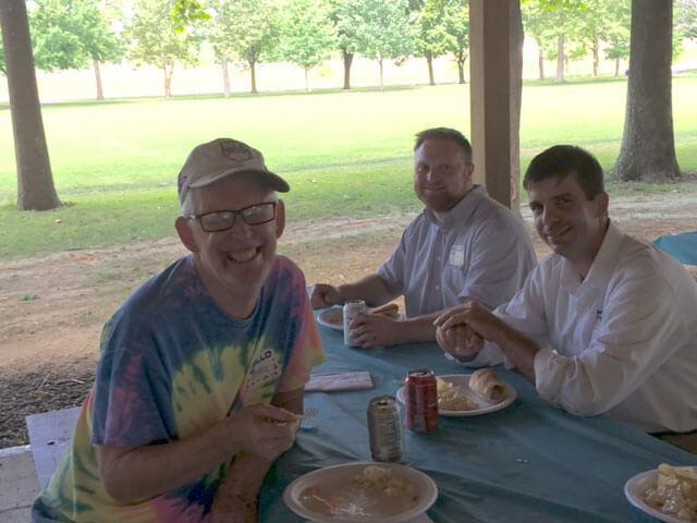 Community habilitation group photo at a picnic